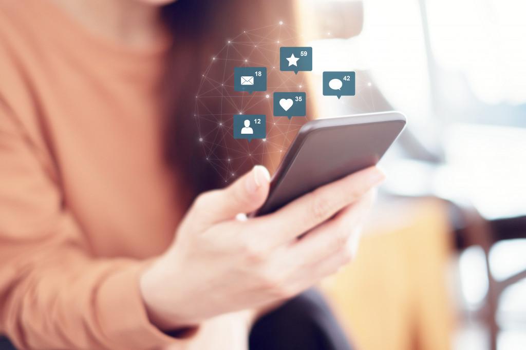 person using social media apps