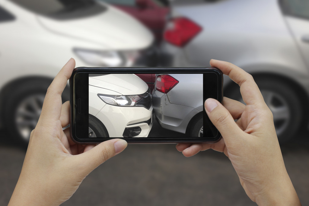 taking a picture of an accident